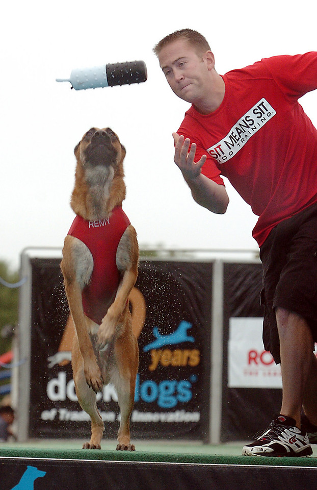 Jon Langdon tosses a decoy for his dog Remy to fetch during the Dock Dogs competition at Broomfield Days on Saturday.<br /> <br /> September 18, 2010<br /> staff photo/David R. Jennings