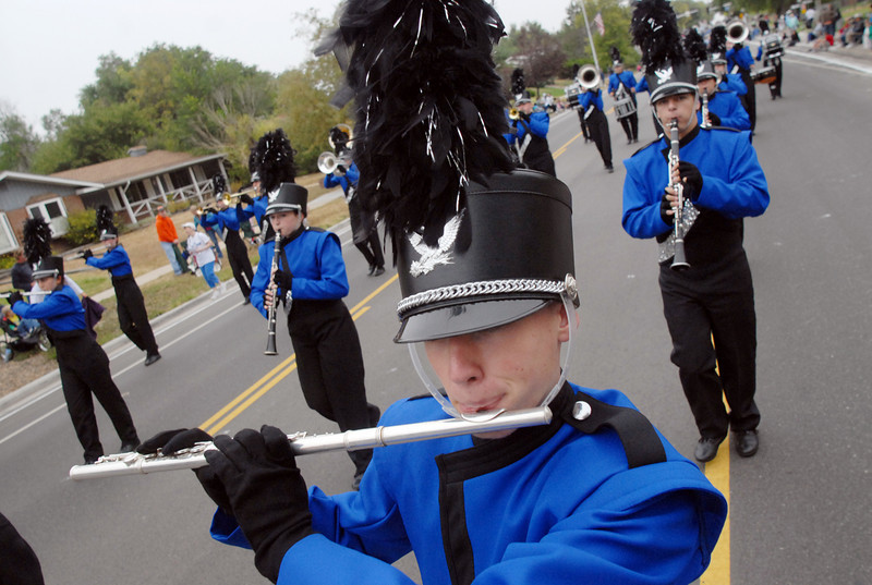 Ben Fulton plays the flute while marching with the Broomfield High band during the parade at Broomfield Days on Saturday.<br /> <br /> September 18, 2010<br /> staff photo/David R. Jennings
