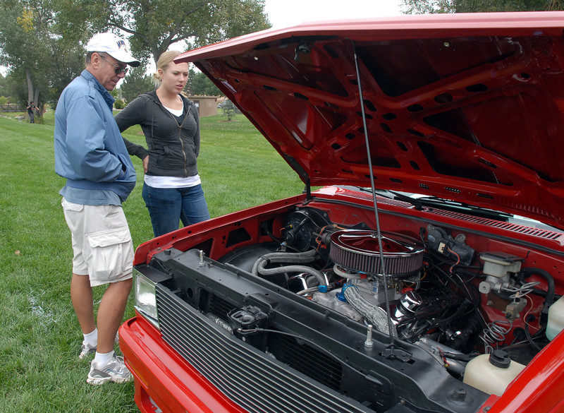 Jim Nuss and his daughter Christina, 16, looks at cars on display in the Rock'n Classic Car Show at Broomfield Days on Saturday.<br /> <br /> September 18, 2010<br /> staff photo/David R. Jennings