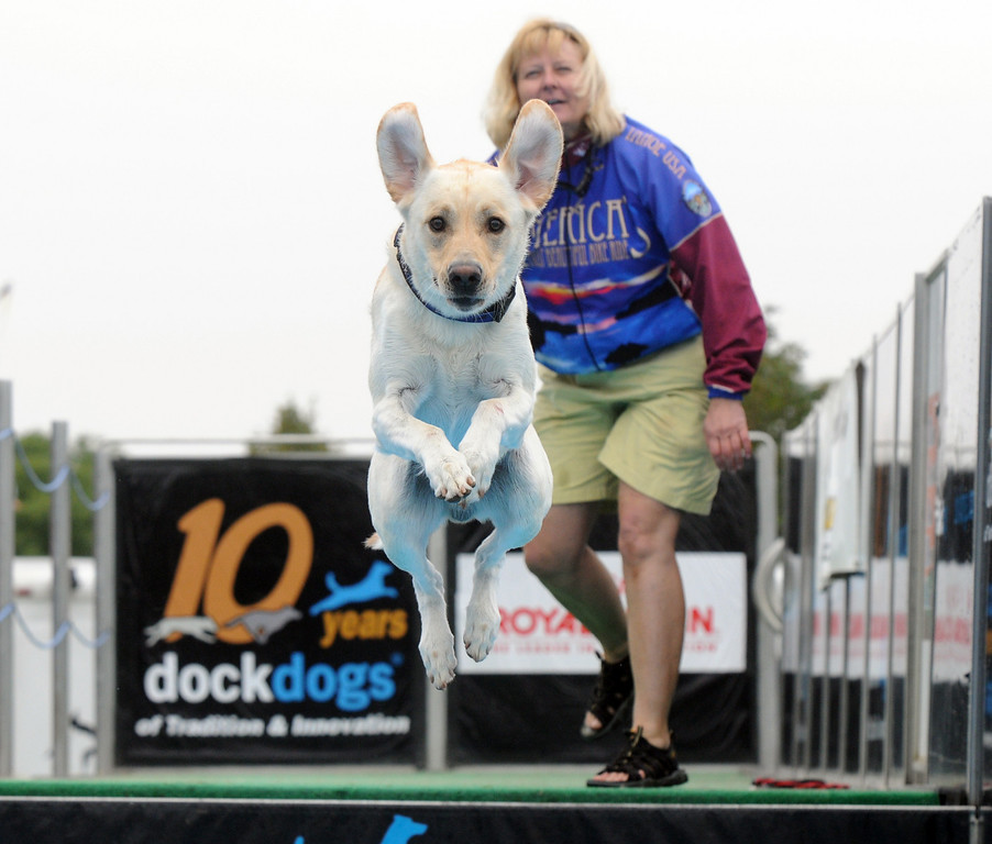 Gloria Mai watches her dog, Sport, jump during the Dock Dogs competition at Broomfield Days on Saturday.<br /> <br /> September 18, 2010<br /> staff photo/David R. Jennings