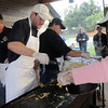 Jon Dewey, left, dishes out eggs he just cooked to Victoria Marchi for the Lions Club breakfast during Broomfield Days at Midway Park on Saturday.<br /> September 17, 2011<br /> staff photo/ David R. Jennings