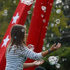 Arianna Bly, 13, chases after bubbles from the bubble machine during Broomfield Days at Midway Park on Saturday.<br /> September 17, 2011<br /> staff photo/ David R. Jennings