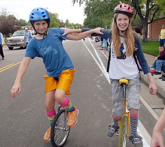 Julie Conn, 12, left, and Killian Dumont, 13, ride unicycles for the Aspen Creek K-8 entry in the Optimist Parade during Broomfield Days on Saturday. September 17, 2011 staff photo/ David R. Jennings