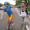 Julie Conn, 12, left, and Killian Dumont, 13, ride unicycles for the Aspen Creek K-8 entry in the Optimist Parade during Broomfield Days on Saturday.<br /> September 17, 2011<br /> staff photo/ David R. Jennings