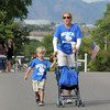 Sue Vanderberg and her son Henry, 4, walk on Midway to catch the Birch Elementary School entry for the parade during Broomfield Days n Saturday.<br /> September 17, 2011<br /> staff photo/ David R. Jennings