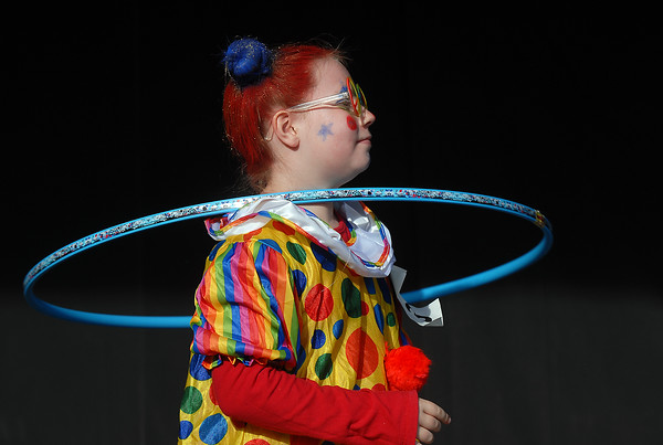 Emily Bower, 9, twirls a hula hoop for the Optimist Clown Contest during Broomfield Days at Midway Park on Saturday.<br /> September 17, 2011<br /> staff photo/ David R. Jennings