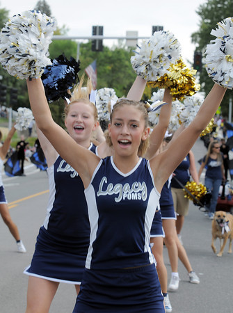 Legacy High Poms  Karley Neal marches during the Optimist Parade at Broomfield Days on Saturday.<br /> September 17, 2011<br /> staff photo/ David R. Jennings