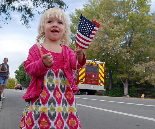 Piper Kuernum, 2, wavs her flag as the parade begins along Midway Boulevard during Broomfield Days on Saturday.<br /> September 17, 2011<br /> staff photo/ David R. Jennings