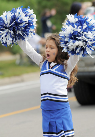 Pilar Durazo, 5, cheers while marching with the Beautiful Savior entry in the Optimist Parade during Broomfield Days on Saturday.<br /> September 17, 2011<br /> staff photo/ David R. Jennings