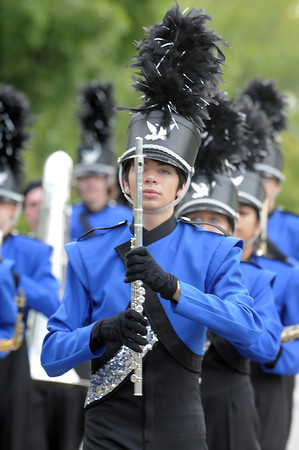 Broomfeild High Marching Band member Quinn Slattery marches in the Optimist Parade at Broomfield Days on Saturday.<br /> September 17, 2011<br /> staff photo/ David R. Jennings