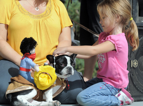 Sophie Suissa, 5, with her dog Jewel dressed as a bullriding French Bulldog for the Best Dressed Dog Contest during Broomfield Days at Midway Park on Saturday.<br /> September 17, 2011<br /> staff photo/ David R. Jennings