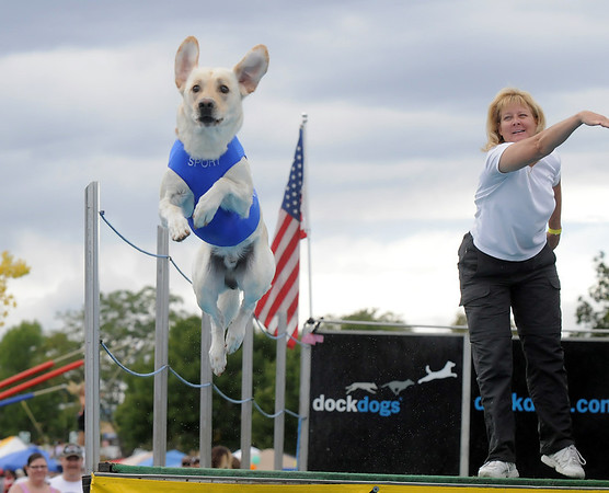 Gloria Mai watches her dog Sportie jump during Dock Dogs at Broomfield Days in Midway Park on Saturday.<br /> September 17, 2011<br /> staff photo/ David R. Jennings