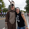 Brenna Fankell, 13, left, dressed as the Aspen Creek Coyote mascot poses with Katalena Laufasa-Duncan during the Optimist Parade at Broomfield Days on Saturday.<br /> September 17, 2011<br /> staff photo/ David R. Jennings