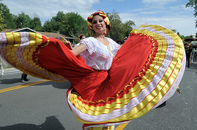 Gladys Zamudio performs a traditional Mexican dance with the Three Margaritas entry during the Optimists Parade at Broomfield Days along Midway Blvd. on Saturday. September 17, 2011 staff photo/ David R. Jennings