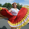 Gladys Zamudio performs a traditional Mexican dance with the Three Margaritas entry during the Optimists Parade at Broomfield Days along Midway Blvd. on Saturday.<br /> September 17, 2011<br /> staff photo/ David R. Jennings
