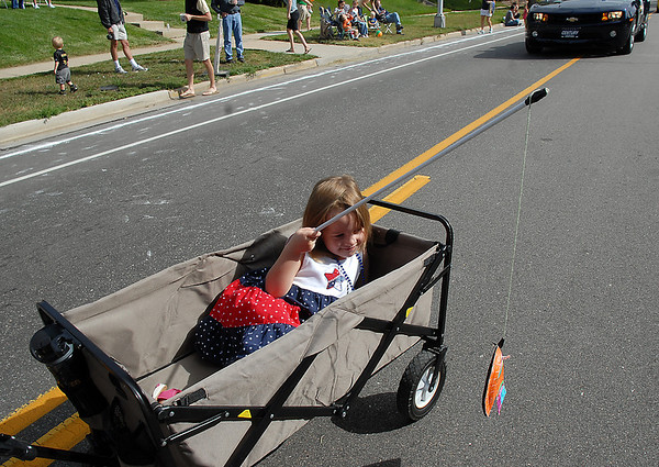 "Madeleine Hoyland, 4, ""fishes"" out of her wagon with Cub Scout Pack 545 during the Optimist Parade at Broomfield Days on Saturday.<br /> September 17, 2011<br /> staff photo/ David R. Jennings"