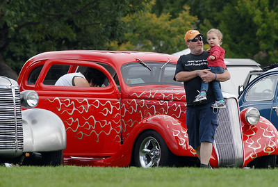 Tim Weeth holds his grand daughter Joeleen Weeth, 2 1/2, as they look at cars in the Rock'n Classic Car Show during Broomfield Days at Midway Park on Saturday. September 17, 2011 staff photo/ David R. Jennings