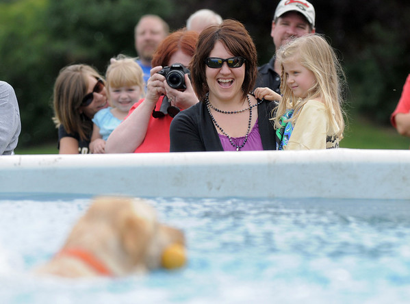 Carmen Murphy and her daughter Corin, 4, watch dogs in the water at the Dock Dogs competition during Broomfield Days on Saturday.<br /> September 17, 2011<br /> staff photo/ David R. Jennings