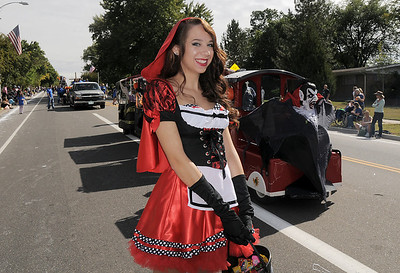 Carly Hinton was dressed as Little Red Riding Hood for the Fun Services entry in the Optimist Parade during Broomfield Days on Saturday. September 17, 2011 staff photo/ David R. Jennings