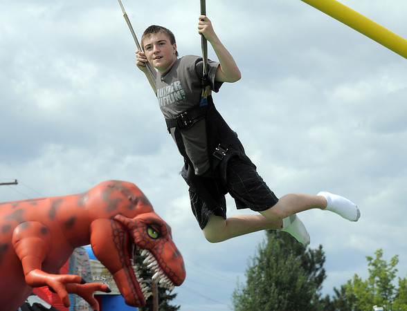 Gavin Johns, 12, bounces in the bunge ride during Broomfield Days at Midway Park on Saturday.<br /> September 17, 2011<br /> staff photo/ David R. Jennings