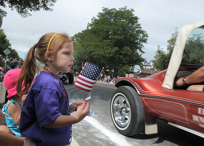 Siena Kidd, 3, waves her flag while watching the El Jebel Shriners cars drive by during the Optimist Parade at Broomfield Days along Midway Blvd. on Saturday. September 17, 2011 staff photo/ David R. Jennings
