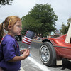 Siena Kidd, 3, waves her flag while watching the El Jebel Shriners cars drive by during the Optimist Parade at Broomfield Days along Midway Blvd. on Saturday.<br /> September 17, 2011<br /> staff photo/ David R. Jennings