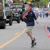 Rylan Crosbie, 6, with Cub Scout Pack 586, runs back to get more candy to hand out with the Broomfield Veterans Memorial Museum entry in the Optimist Parade during Broomfield Days on Saturday.<br /> September 17, 2011<br /> staff photo/ David R. Jennings