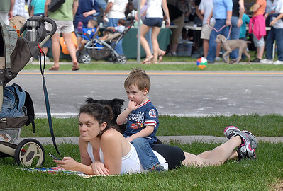 Charlotte Syre and her son Izaak, 2 1/2,  rest after watching the parade during Broomfield Days at Midway Park on Saturday. September 17, 2011 staff photo/ David R. Jennings