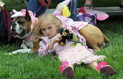 Hannah Craig, 5, rests on her dog Melody before competing in the Best Dressed Dog Contest during Broomfield Days at Midway park on Saturday. September 17, 2011 staff photo/ David R. Jennings