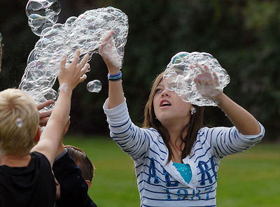 Arianna Bly, 13, catches bubbles from the bubble machine during Broomfield Days at Midway Park on Saturday. September 17, 2011 staff photo/ David R. Jennings
