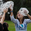 Arianna Bly, 13, catches bubbles from the bubble machine during Broomfield Days at Midway Park on Saturday.<br /> September 17, 2011<br /> staff photo/ David R. Jennings