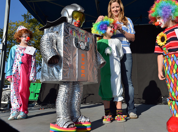 "Mattison ""Matti"" Verseman, 4, center, dressed as a robot clown for the Optimist Clown Contest at Broomfield Days.<br /> September 15, 2012<br /> staff photo/ David R. Jennings"