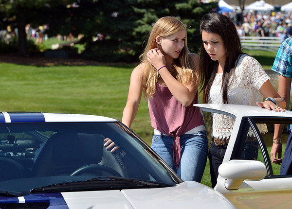Amber Rafiferty, 15, left, and Emily Chavez, 15, look at an exotic car in the car show during Broomfield Days at Midway Park.<br /> September 15, 2012<br /> staff photo/ David R. Jennings