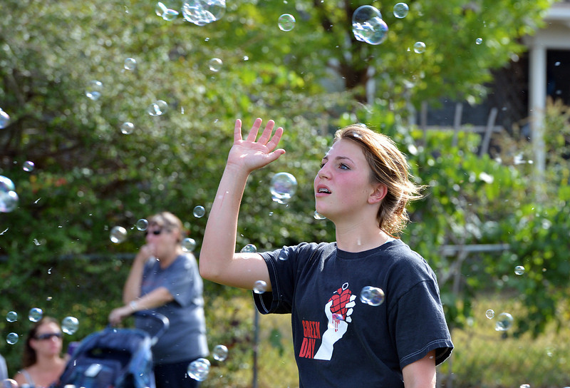 Nicole Guran, 12, plays with bubbles from the bubble machine during Broomfield Days at Midway Park.<br /> September 15, 2012<br /> staff photo/ David R. Jennings