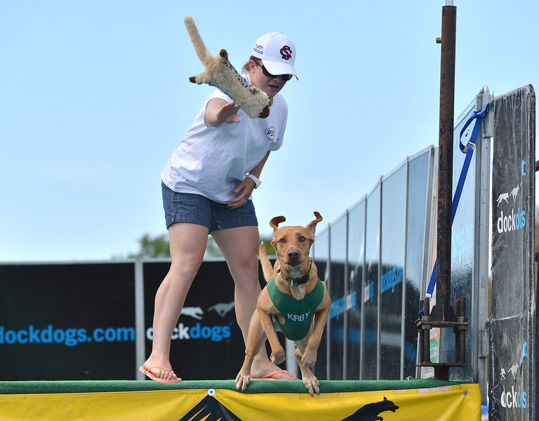 Erin Owen tosses a toy for her dog Kirby for the Dock Dogs Competition during Broomfield Days at Midway Park.<br /> September 15, 2012<br /> staff photo/ David R. Jennings