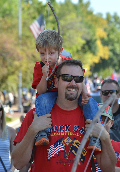 Sawyer Schrek, 3, holding a bow, sits on the shoulders of his father, Steve, while marching with Cub Scout Pack 545 in the parade during Broomfield Days at Midway Park.<br /> September 15, 2012<br /> staff photo/ David R. Jennings