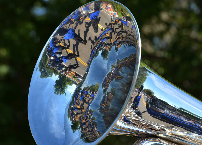 A tuba reflects the Broomfield High Marching Band in the parade during Broomfield Days at Midway Park.<br /> September 15, 2012<br /> staff photo/ David R. Jennings