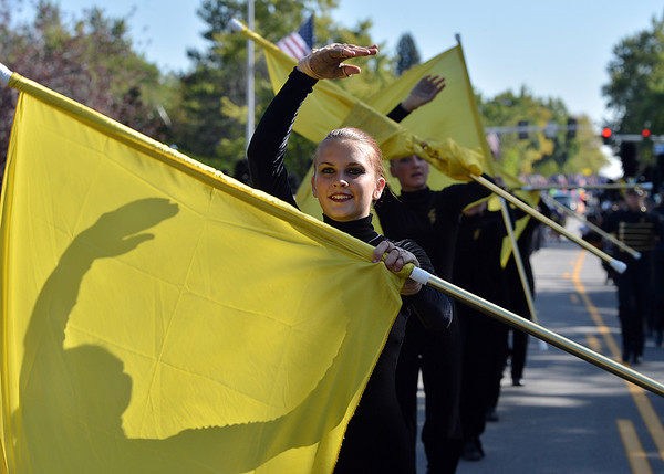 Alex Trujillo performs a flag routine with the Legacy Marching Band during the parade at Broomfield Days.<br /> September 15, 2012<br /> staff photo/ David R. Jennings