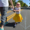 Eleanor Marshall, 3, walks with her mother in the Apple Tree Preschool entry in the parade during Broomfield Days at Midway Park.<br /> September 15, 2012<br /> staff photo/ David R. Jennings