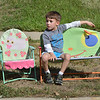 Nathan Gray, 5, watches the parade from his couch at theedge of Midway Blvd.  during Broomfield Days at Midway Park.<br /> September 15, 2012<br /> staff photo/ David R. Jennings