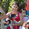 Alyssa Velasquez holds her dog Bob dressed as a cowboy for the Best Dressed Dog Contest during Broomfield Days at Midway Park.<br /> September 15, 2012<br /> staff photo/ David R. Jennings