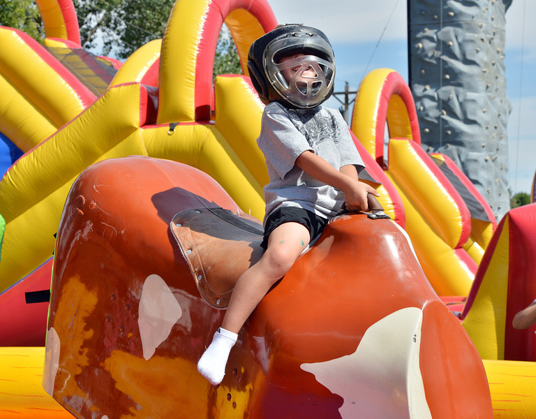 Blake Barnett, 5, rides a mechanical bull during Broomfield Days at Midway Park.<br /> September 15, 2012<br /> staff photo/ David R. Jennings