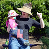 Shannon Szameitat tries to get her daughter Emmie, 1, to wave at participants in the parade during Broomfield Days at Midway Park.<br /> September 15, 2012<br /> staff photo/ David R. Jennings