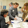 Sean Brady, left, Michael Byrne and Shannon Colton look over materials for their precinct 20 caucus during the Broomfield County Democratic caucus at Broomfield High School on Tuesday. <br /> March 6, 2012 <br /> staff photo/ David R. Jennings