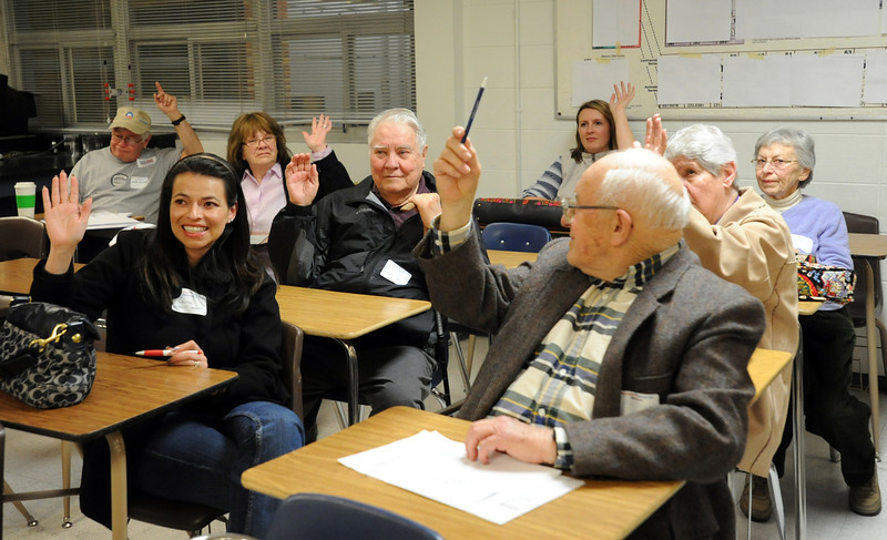 Members of precinct 33 caucus raise their hands for the presidential re-election straw poll duiring the Broomfield County Democratic caucus at Broomfield High School on Tuesday. <br /> March 6, 2012 <br /> staff photo/ David R. Jennings