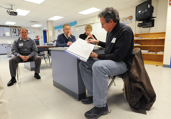 Sean Brady, right, studies the caucus book for precinct 20 during the Broomfield County Democratic caucus at Broomfield High School on Tuesday. <br /> March 6, 2012 <br /> staff photo/ David R. Jennings