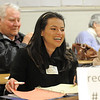Gina Valdez, caucus secretary for precinct 33, laughs while recording during the Broomfield County Democratic caucus at Broomfield High School on Tuesday. <br /> March 6, 2012 <br /> staff photo/ David R. Jennings