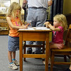 Rhea Belanger, 6, left, and her sister Phoebe, 2, color pictures in the passenger waiting room during the Broomfield Depot Museum open house on Saturday.<br /> <br /> June23, 2012<br /> staff photo/ David R. Jennings
