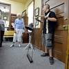 Tour guide Michael Sheinberg, 17, right, shows  Diane Barbour, left, and Lois Jouett  a lawn mower during a tour of the Broomfield Depot Museum for the open house on Saturday.<br /> <br /> June23, 2012<br /> staff photo/ David R. Jennings