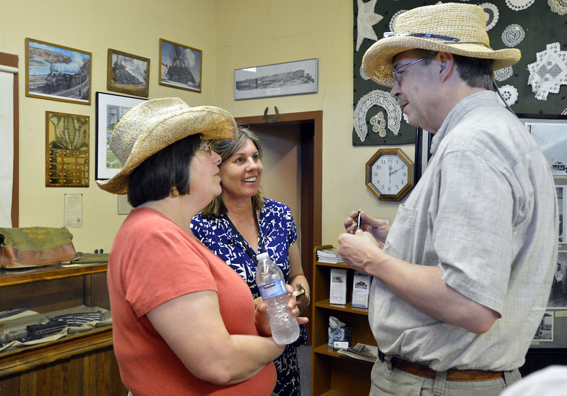 Museum Administrator Jacqui Ainlay-Conley, center, chats with Libby Schultz, left, and her husband Mark during the Broomfield Depot Museum open house on Saturday.<br /> <br /> June23, 2012<br /> staff photo/ David R. Jennings